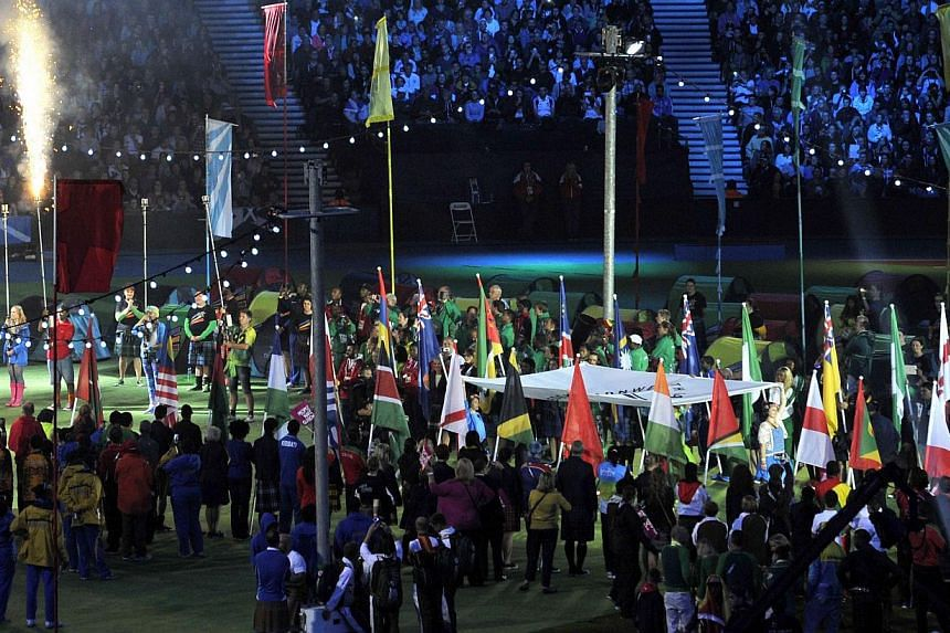 The Commonwealth Games Federation flag is lowered during the closing ceremony of the 2014 Commonwealth Games at Hampden Park in Glasgow, Scotland, on Aug 3, 2014. -- PHOTO: AFP