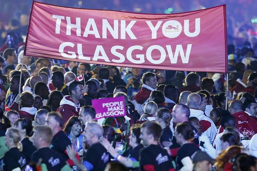 A banner is held up among athletes attending the closing ceremony of the 2014 Commonwealth Games at Hampden Park in Glasgow, Scotland on Aug 3, 2014. -- PHOTO: REUTERS