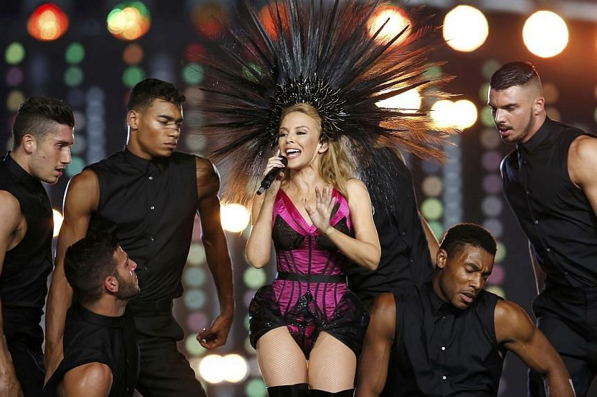 Australian singer Kylie Minogue performing during the closing ceremony of the 2014 commonwealth games at Hampden Park in Glasgow, Scotland, on Aug 3, 2014.-- PHOTO: AFP