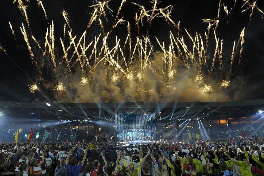 """Fireworks light up the sky during the closing ceremony of the 2014 Commonwealth Games at Hampden Park in Glasgow, Scotland, on Aug 3, 2014.Hailed as the """"best ever"""" Commonwealth Games, Glasgow 2014 has enthralled live crowds and audiences the w"""