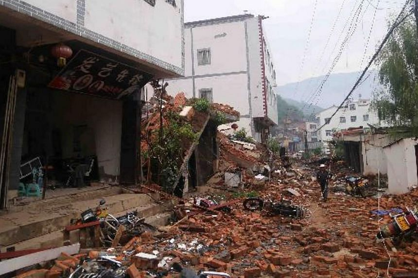 Walls fall off local buildings after a 6.5-magnitude earthquake hit Ludian county in south-west China's Yunnan province on Aug 3, 2014. -- PHOTO: CHINA DAILY/ASIA NEWS NETWORK