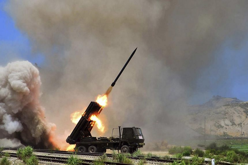 A rocket launcher during an exercise in this undated photo released by North Korea's Korean Central News Agency (KCNA) in Pyongyang on July 15, 2014. Japan finds itself surrounded by a worsening security environment as North Korea pushes forward with