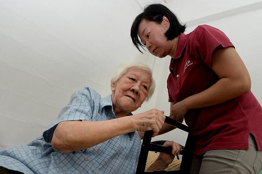Ms Jacinda Soh (right), an occupational therapist with Touch Home Care, a voluntary welfare organisation that provides home-care services for the elderly, with Madam Doreen Lim, who lives alone in a one-room rental flat.The Health Ministry is w