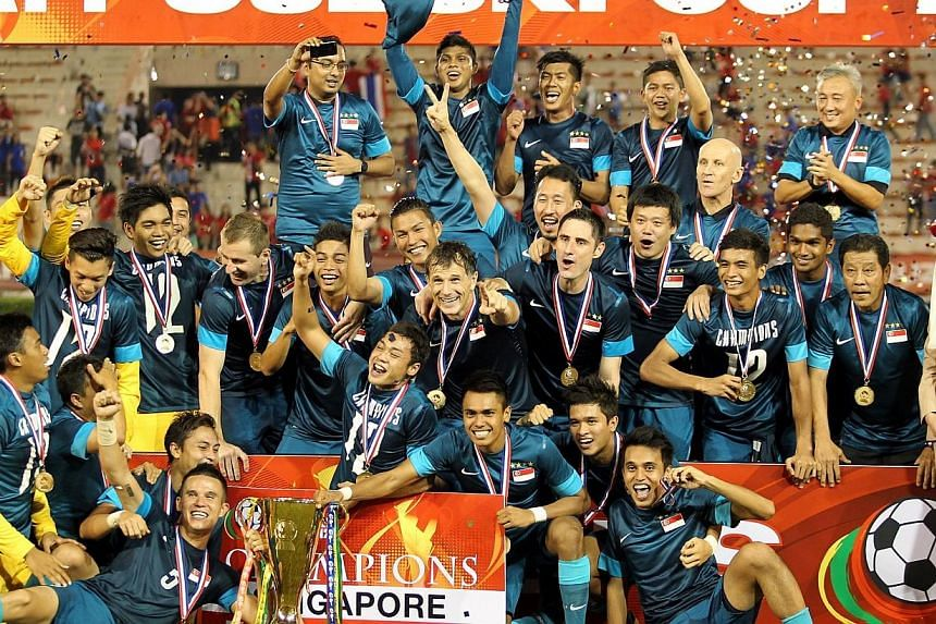 The Singapore football team celebrates after winning the AFF Suzuki Cup final against Thailand at the Supachalasi Stadium in Bangkok on Dec 22, 2012. Co-hosts Singapore have been drawn to face Malaysia, three-time champions Thailand and the qualifyin
