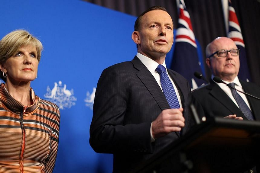 Prime Minister Tony Abbott (centre) speaks at a joint press conference with Foreign Minister Julie Bishop and Attorney General George Brandis (right) in Canberra on Tuesday, Aug 5, 2014.Australia will toughen laws to target home-grown terrorist