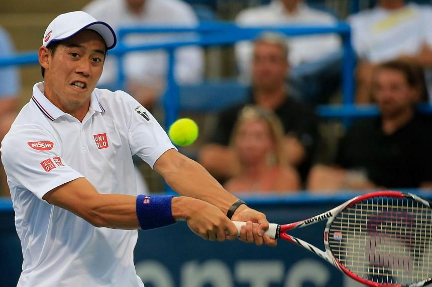 Kei Nishikori of Japan returns a shot to Richard Gasquet of France during the Citi Open at the William H.G. FitzGerald Tennis Center on Aug 1, 2014, in Washington, DC.Tennis star Kei Nishikori faces a race against time to be fit for this month'