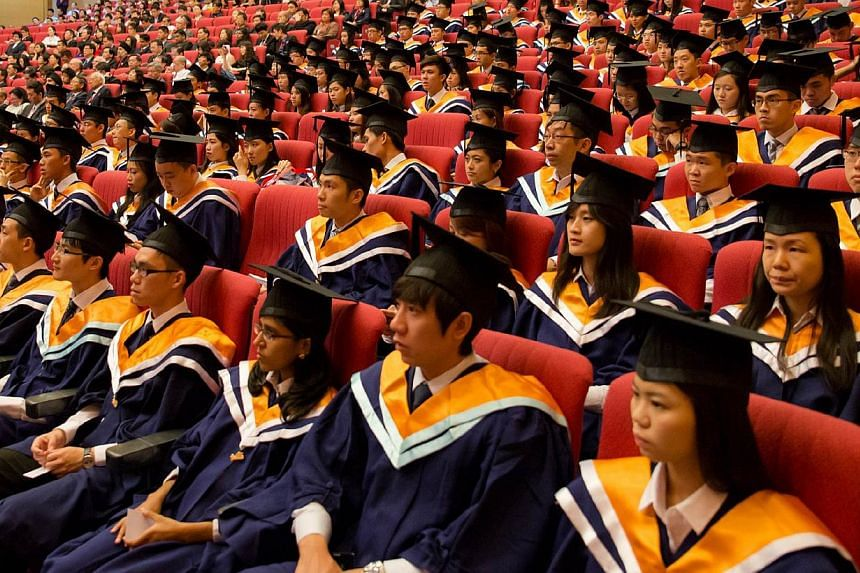 Nanyang Technological University graduates at their convocation ceremony. More undergraduates are taking up double degrees and majors outside their disciplines, in a bid to broaden their knowledge and become more employable. -- PHOTO: NANYANG TECHNOL