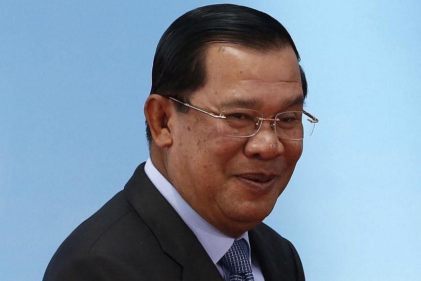 Mr Hun Sen (above) showed off Cambodia's future leader in Thailand.