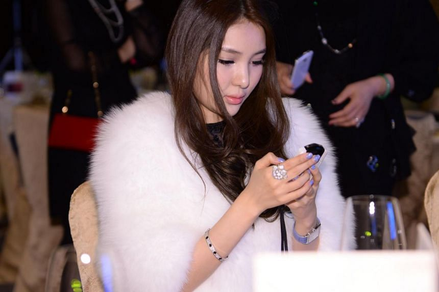 This picture taken on Dec 1, 2013, shows Guo Meimei attending a jewellery auction in Beijing.Guo, who sparked online controversy by flaunting her wealth three years ago, has come under the media spotlight again for her involvement in the sex tr