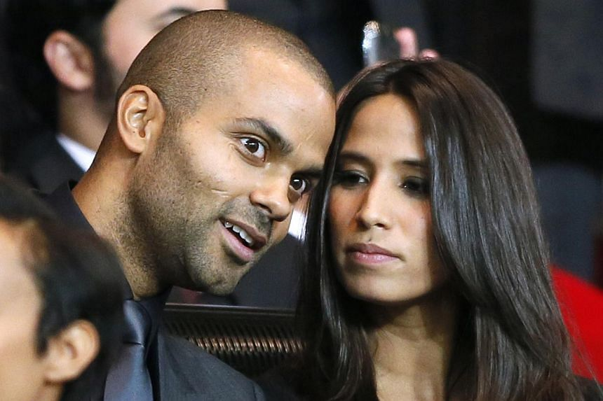 A September 18, 2012 file photo shows French NBA and international basketball player Tony Parker with his girlfriend Axelle Francine during the UEFA Champions League match between Paris Saint-Germain (PSG) and FC Dynamo Kiev, at the Parc des Princes