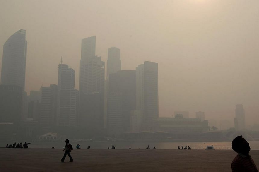 The Singapore skyline on June 20, 2013, as the Pollutant Standards Index (PSI) hit 371 at 1pm. -- PHOTO: THE BUSINESS TIMES FILE