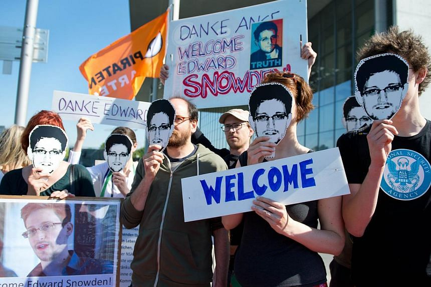 Activists wearing masks featuring US intelligence leaker Edward Snowden at a rally on May 22, 2014, in Berlin. US intelligence officials were considering on Tuesday whether to open a criminal investigation into the suspected leak of a classified coun