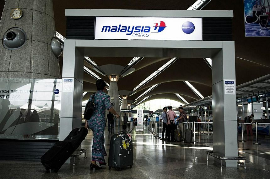 The Kuala Lumpur International Airport in Sepang on July 21, 2014. Malaysia has included Ebola screening for those arriving from the Philippines, the United States and Britain. -- PHOTO: AFP