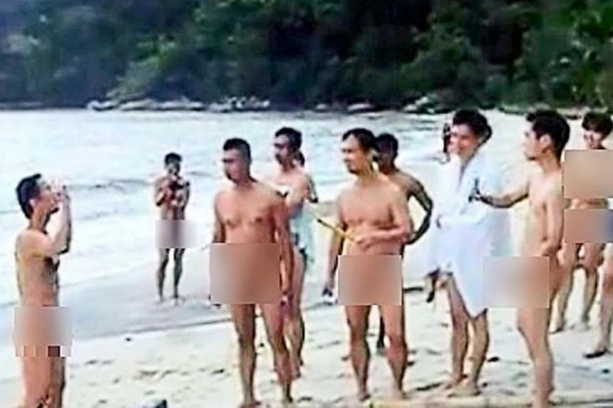 A still from a video showing 'naturists' participating in nude sports games at a beach said to be located in Teluk Bahang, Penang. --PHOTO: THE STAR/ASIA NEWS NETWORK