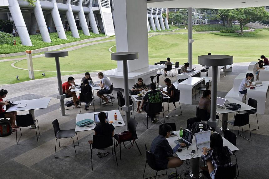 Students studying at the National University of Singapore's (NUS) University Town.Ten dengue cases have been reported in the UTown, home to some 1,800 students, making it a high-risk dengue cluster according to latest National Environment Agenc