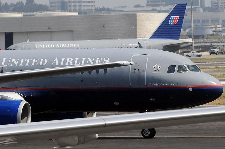 A 2009 photo shows a United Airlines aircraft preparing to take off from the international airport in San Francisco, California. A United Airlines jet on its way to Brussels made an emergency landing in Halifax, Nova Scotia after a small fire a