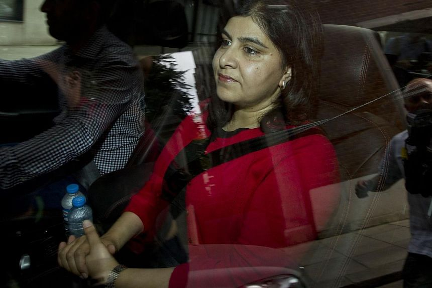 Britain's former senior minister of state at the Foreign and Commonwealth Office and minister for faith and communities, Baroness Warsi, is driven away from her home in central London on August 5, 2014, after she resigned over the government's positi