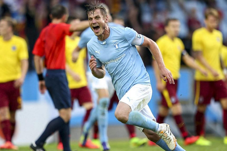 Malmo's Markus Rosenberg celebrates after scoring his second goal during the Champions League match between Malmo and Sparta Prague at Swedbank stadium in Malmo on Aug 6, 2014. -- PHOTO: REUTERS