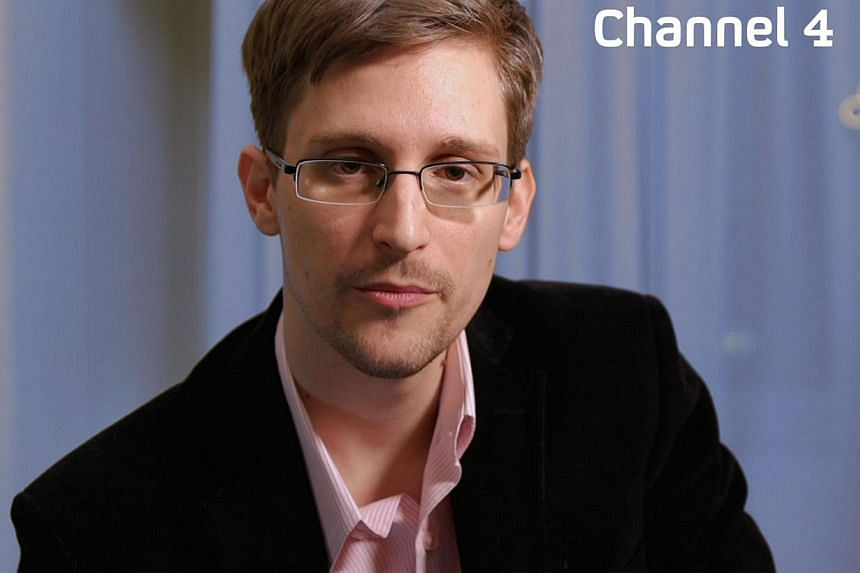 An undated handout photo received from Channel 4 on Dec 24, 2013 shows US intelligence leaker Edward Snowden preparing to make his television Christmas message.Former U.S. intelligence contractor Edward Snowden has received a three-year residen
