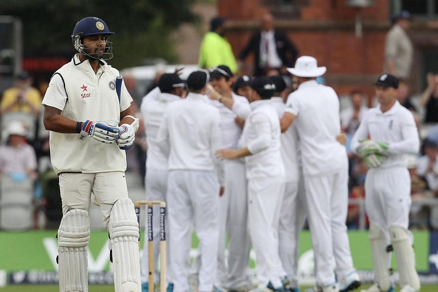 India's Murali Vijay leaves the pitch following his dismissal for no runs during the first day of the fourth cricket Test match between England and India at Old Trafford in Manchester on Thursday, Aug 7, 2014. India's cricketers collapsed specta