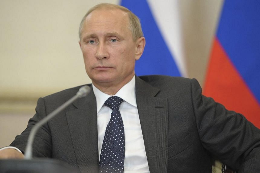 Russia's President Vladimir Putin chairs a session of the State Council Presidium in Voronezh on Aug 5, 2014. Mr Putin's domestic approval rating has soared to 87 per cent, pollsters said. -- PHOTO: REUTERS