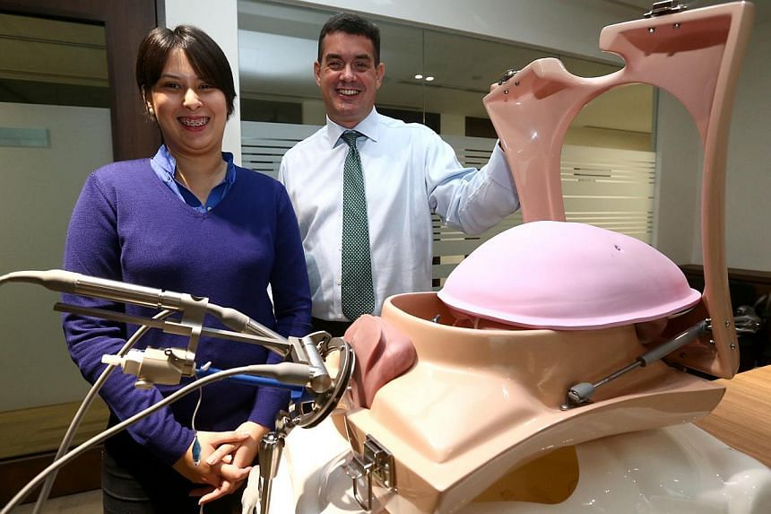 Ms Vargilia Bridget Welford, 27, and Dr Peter Barton-Smith at a demonstration of how ViKY works. Ms Welford underwent surgery in March for endometriosis using ViKY and took just half the time to recover.