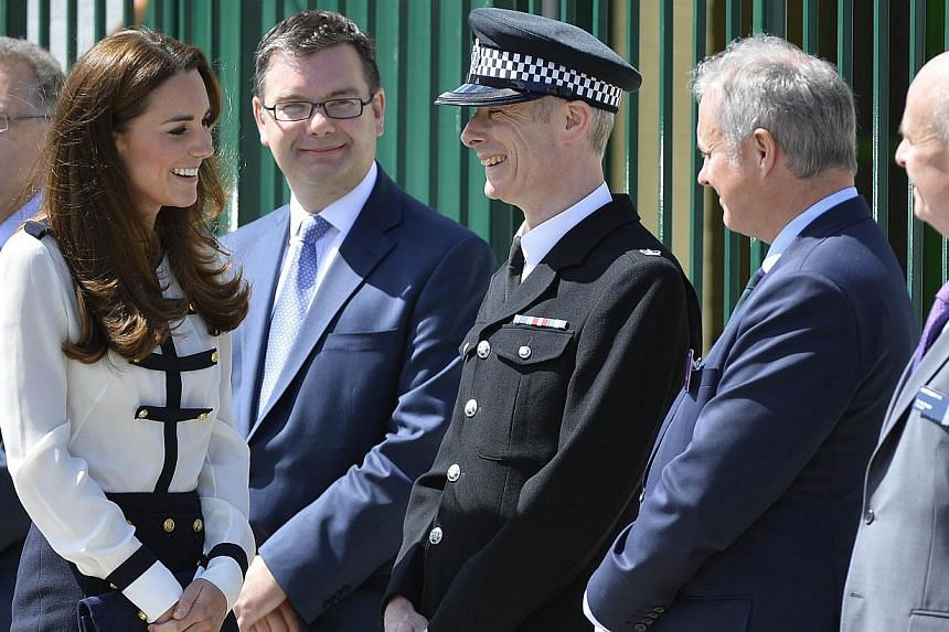 Britain's Catherine, Duchess of Cambridge, visiting World War II code-breaking siteBletchley Park in southern England on June 18, 2014. She has been a fixture on Vanity Fair's best-dressed list for four years and this year makes it to the magaz