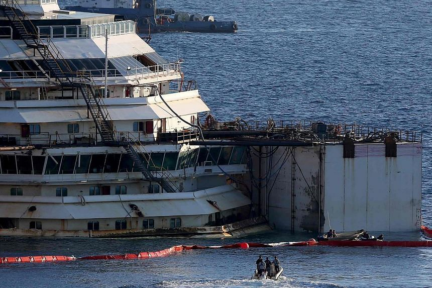 The cruise liner Costa Concordia is seen at Giglio harbour ahead of it being towed away July 15, 2014. The wreck of the luxury liner was refloated in July to be towed away and broken up for scrap, more than two years after it capsized off the Italian