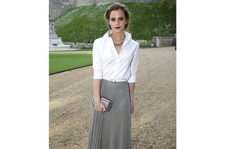 Actress Emma Watson arrives for a dinner hosted by Britain's Prince William at Windsor Castle in southern England on May 13, 2014. She is a first-timer on the Vanity Fair best-dressed list. -- PHOTO: REUTERS