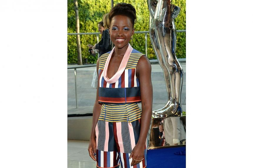 Actress Lupita Nyong'o attending the 2014 CFDA fashion awards in New York on June 2, 2014. It is a first-time appearance for Nyong'o on the Vanity Fair list. -- PHOTO: AFP