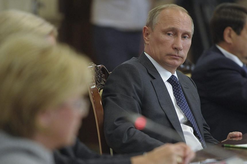 Russia's President Vladimir Putin chairing a session of the State Council Presidium in Voronezh on August 5, 2014. Putin has ordered his government to come up with a list of goods to be banned for imports into Russia and to last one year, the Kremlin