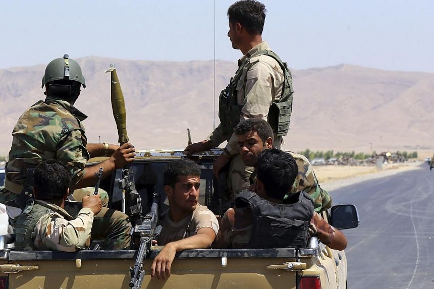 Kurdish peshmerga troops participate in an intensive security deployment against Islamic State militants in Makhmur, on the outskirts of the province of Nineveh on Aug 7, 2014.US military aircraft conducted an airstrike on Friday, Aug 8, 2014,
