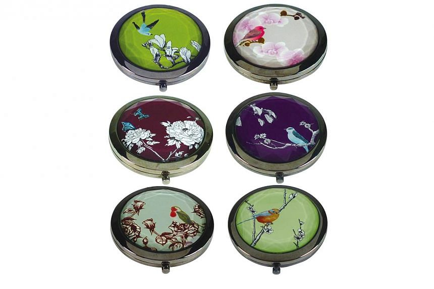 Shoppers atThe Clementi Mallwill be able toreceive an enamel compact mirror, available in six designs, when they shop at the mall. -- PHOTO: SPH