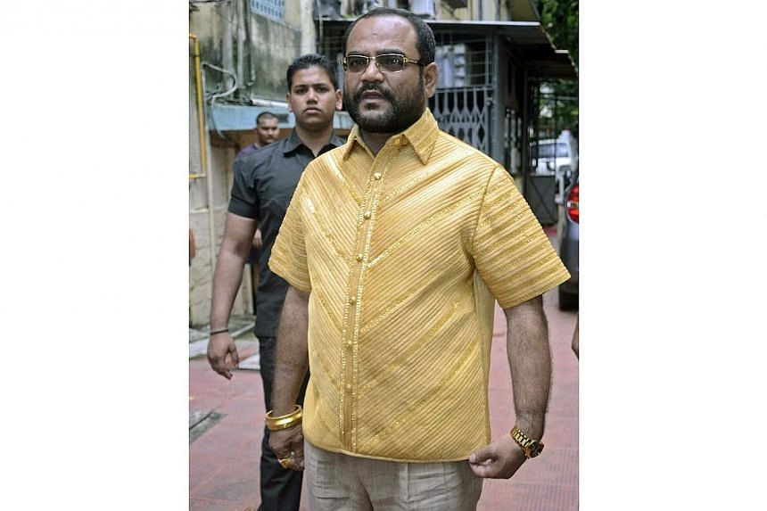 Mr Parakh loves gold so much that he commissioned a solid gold shirt, weighing more than 4kg, for his 45th birthday on Friday. -- PHOTO: EPA