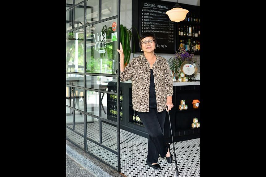 After suffering a stroke, Ms Violet Oon uses a walking stick in case she loses her balance. -- PHOTO: DIOS VINCOY JR FOR THE STRAITS TIMES