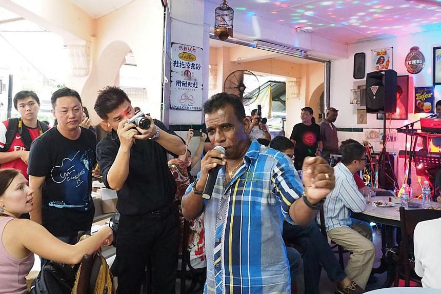 This laid-back series of concerts located in coffeeshops across George Town sees the combined talent of local musicians such as Joe Pragasam (above), artists, poets and even a magician under one roof.--PHOTO: ERFENDI DHAHLAN
