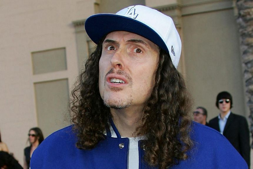 This November 21, 2006 file photo shows US pop satirist Weird Al Yankovic as he arrives for the American Music Awards in Los Angeles, California. An online petition to get chart-topping parody singer 'Weird Al' Yankovic to headline the highly coveted