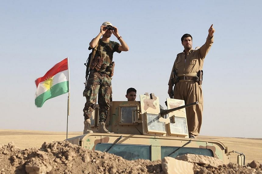 Kurdish peshmerga troops participate in an intensive security deployment against Islamic State militants on the front line in Khazer on Aug 8, 2014.Unites States President Barack Obama on Saturday, Aug 9, 2014, vowed to continue air strikes aga