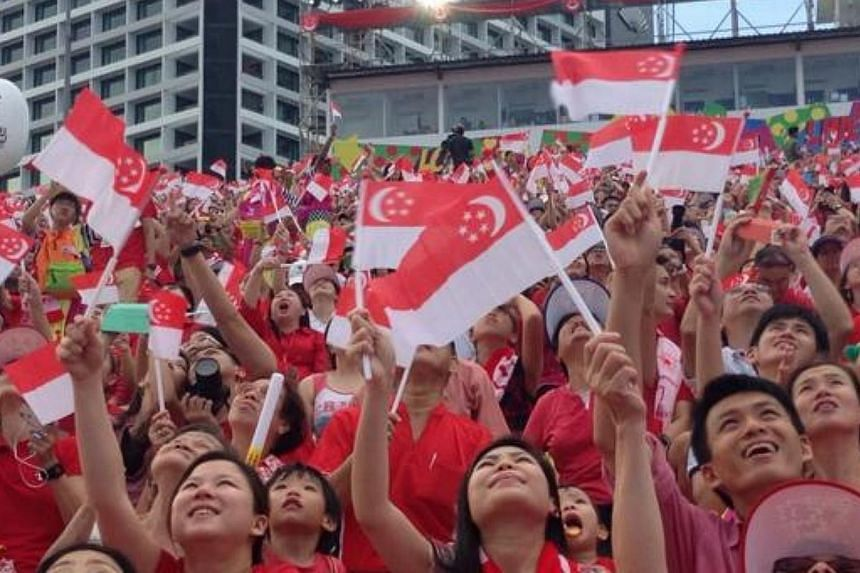 Spectators are transfixed by the Red Lions' display. -- ST PHOTO: YEO SAM JO