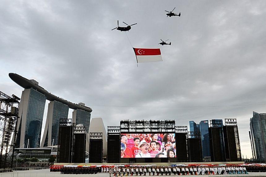 Singapore celebrates its 49th year of independence at the Marina Bay Floating Platform. -- PHOTO: LIM YAOHUI FOR THE STRAITS TIMES