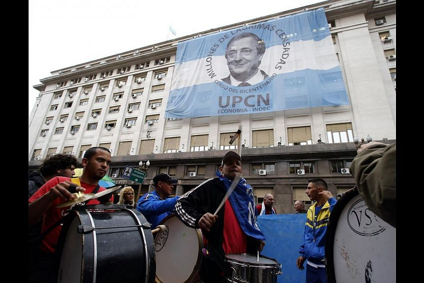Pro-government demonstrators beating drums in front of the Economy Ministry in Buenos Aires on July 31. US Judge Griesa's ruling - preventing Argentina from paying its creditors - encourages usurious behaviour, threatens the functioning of internatio