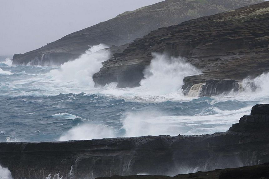 Large waves crash into the sea cliffs east side of Oahu as Tropical Storm Iselle passes through the Hawaiian islands, in Honolulu, Hawaii on Aug 8, 2014. Hawaii breathed a sigh of relief after escaping serious damage from Tropical Storm Iselle o