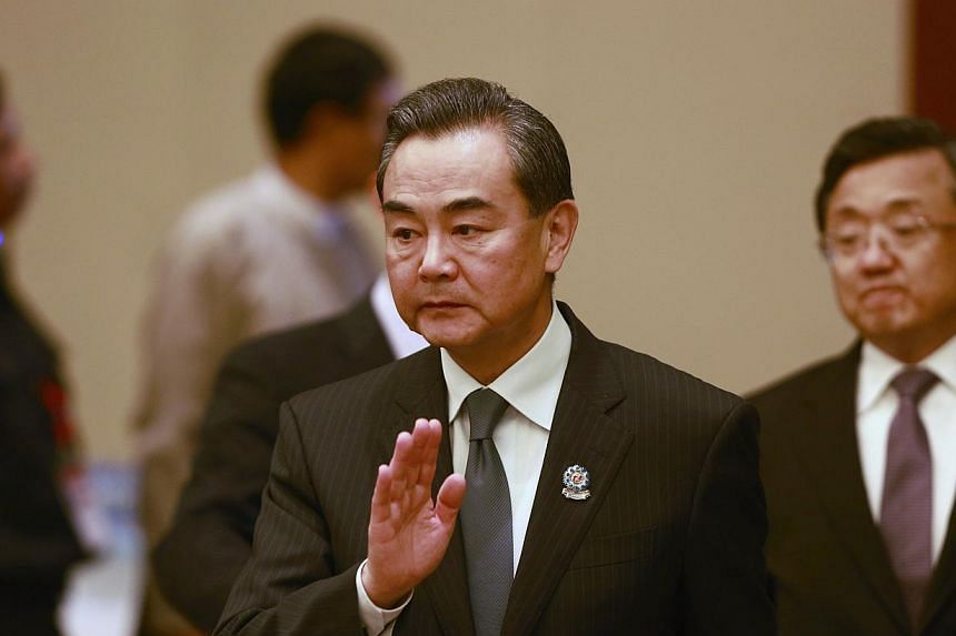 Chinese Foreign Minister Wang Yi waves as he arrives to attend an Asean-China ministerial meeting at the Myanmar International Convention Centre (MICC) in Naypyitaw, on Aug 9, 2014. -- PHOTO: REUTERS