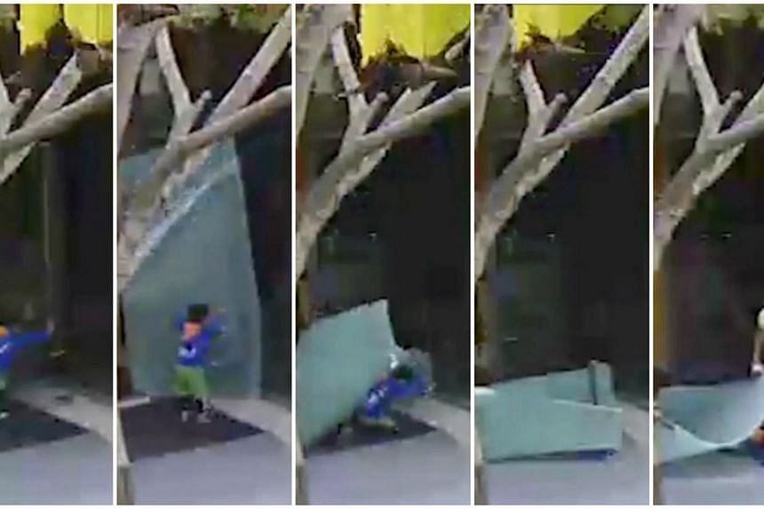 A four-year-old boy suffered cuts on his head after a 3m-tall glass door at Westgate mall broke off and fell on him. -- SCREENGRAB: WESTGATE MALL/THE NEW PAPER