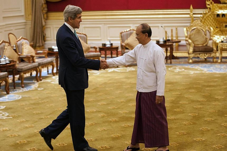 US Secretary of State John Kerry (left) shakes hands with Myanmar President Thein Sein (right) during their meeting at the Presidential hall outside the venue of the 47th Asean Foreign Ministers' Meeting in Naypyidaw on Aug 9, 2014. Mr Kerry on
