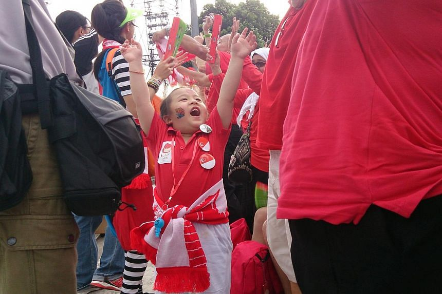 Spectators decked in red and white filled the stands, as this year's National Day Parade got off to a roaring start. -- ST PHOTO: STEFFI KOH