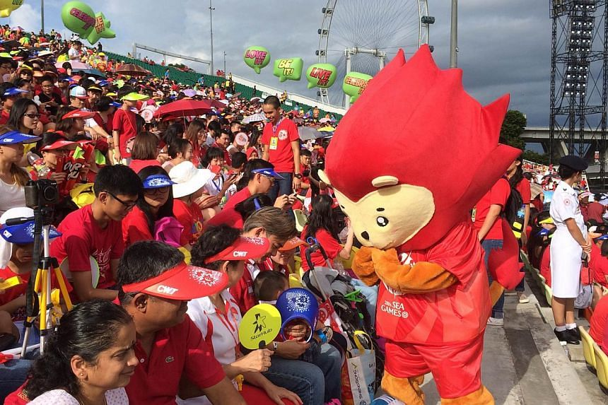 Spectators decked in red and white filled the stands, as this year's National Day Parade got off to a roaring start.--PHOTO: LIM YAOHUI FOR THE STRAITS TIMES