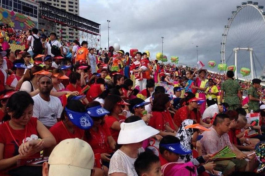 Spectators decked in red and white filled the stands, as this year's National Day Parade got off to a roaring start.--ST PHOTO: YEO SAM JO