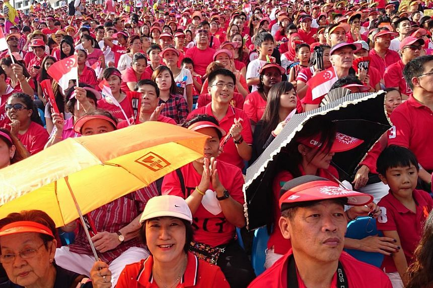 Spectators decked in red and white filled the stands, as this year's National Day Parade got off to a roaring start. -- ST PHOTO: RAJ NADARAJAN