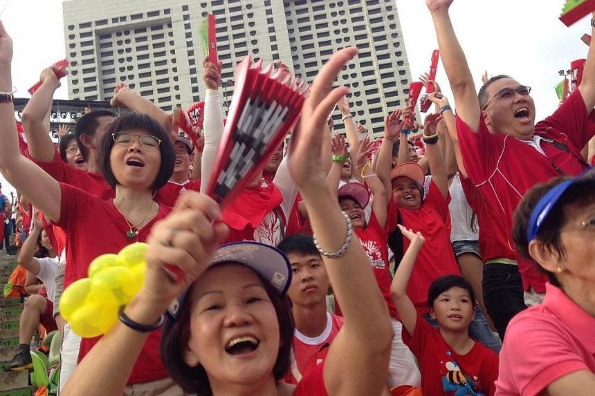 Spectators decked in red and white filled the stands, as this year's National Day Parade got off to a roaring start. -- ST PHOTO: NEO XIAOBIN